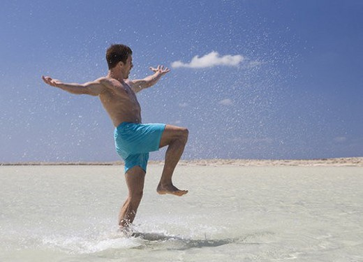 A man splashing in the sea : Stock Photo