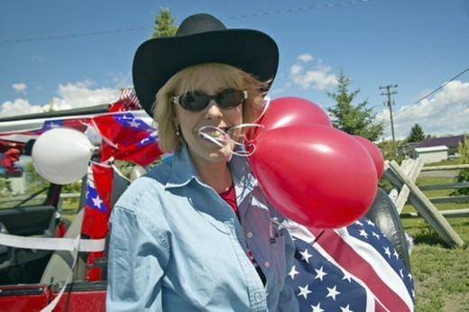 Woman with balloons and decorated red, white and blue car : Stock Photo
