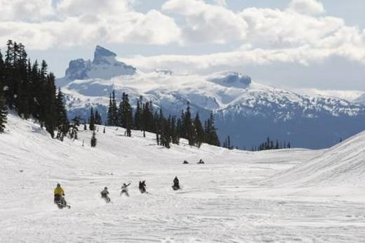 Stock Photo: 4029R-223976 snowmobile adventure tour in Whistler British Columbia