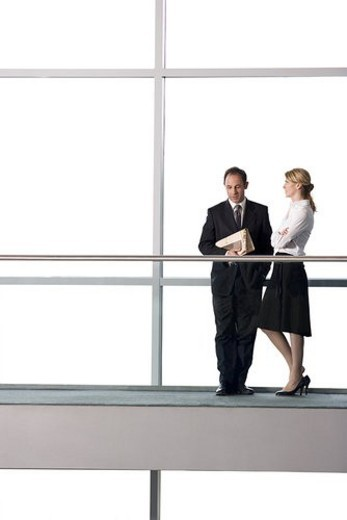 Stock Photo: 4029R-224701 Businessman and woman talking in modern office building