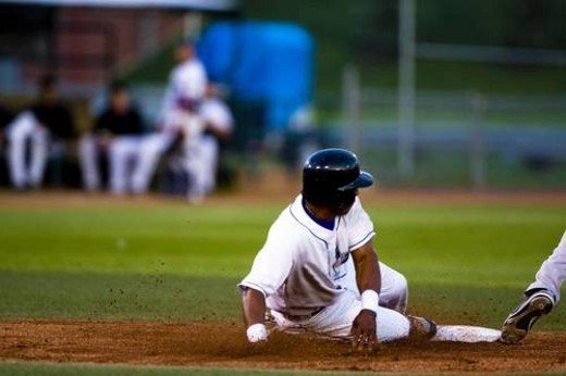 Stock Photo: 4029R-224912 Baseball player sliding onto a base