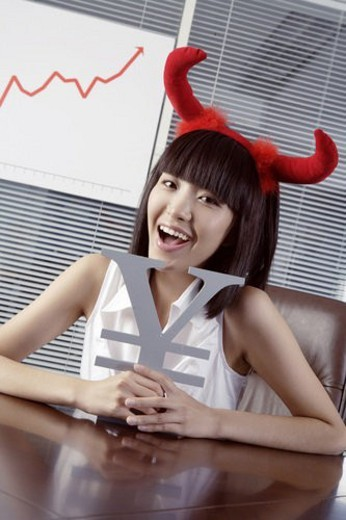 Stock Photo: 4029R-225761 Young woman wearing two red horn, holding RMB symbol