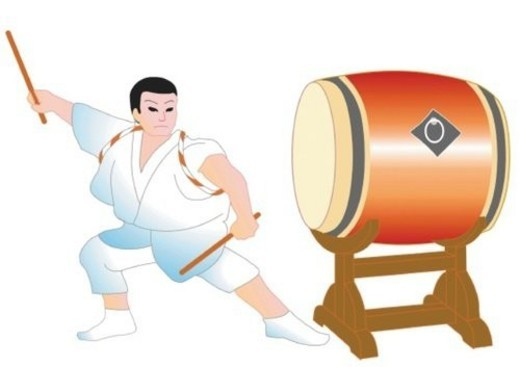Man beating a Japanese double drum, front view, Japan : Stock Photo