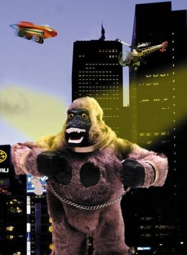 Toy Doll, King Kong and Buildings, Front View, Blurred Motion : Stock Photo