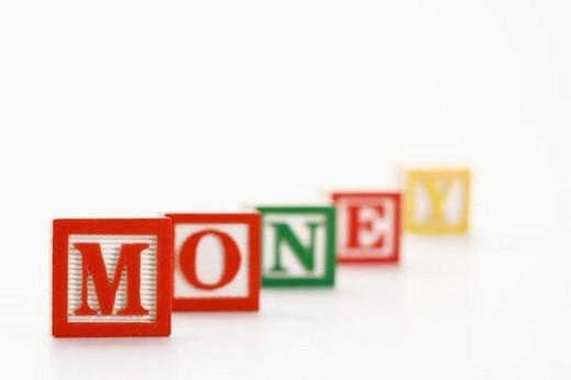 Stock Photo: 4029R-228474 Alphabet toy building blocks spelling the word money.