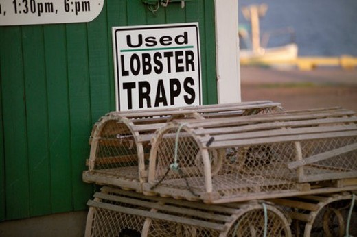 Stock Photo: 4029R-229822 Lobster traps stacked outside an establishment in Prince Edward Island, Canada