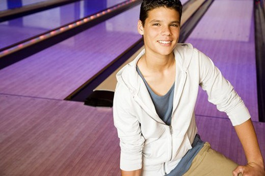 Teenage boy in a bowling alley : Stock Photo