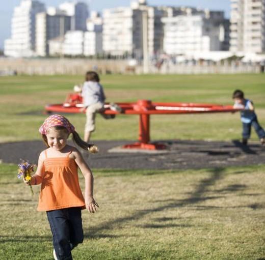 Three children on a playground : Stock Photo