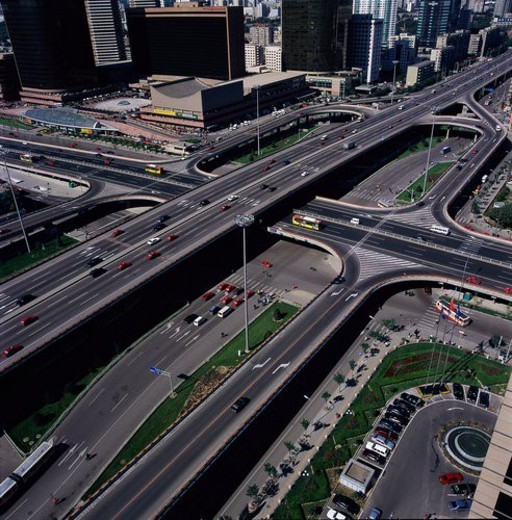 Cars and cloverleaf junction,Beijing : Stock Photo