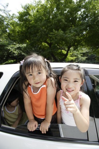 Stock Photo: 4029R-235322 Children in a car