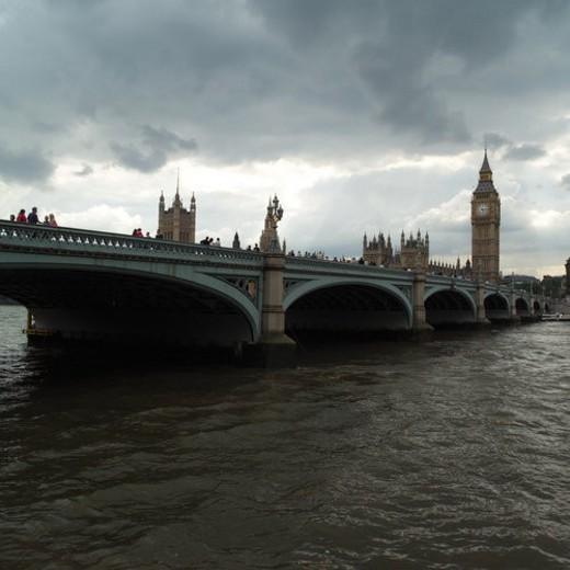 Bridge spanning across the river Thames, London, England : Stock Photo