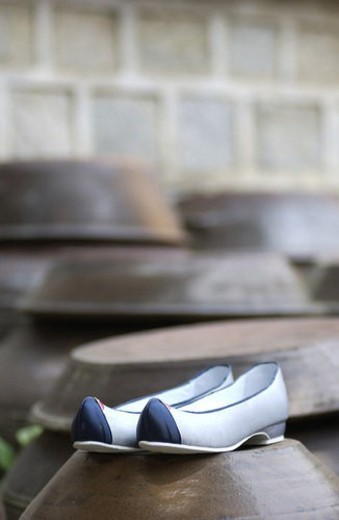 Stock Photo: 4029R-236994 craft, korean shoes, ceramic, jar, rubber shoes, jars, tradition