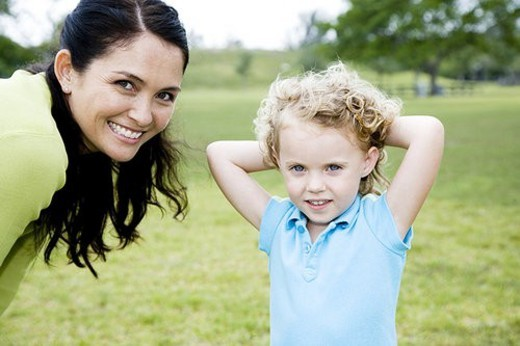 Stock Photo: 4029R-239486 mother and daughter posing for photograph in the park