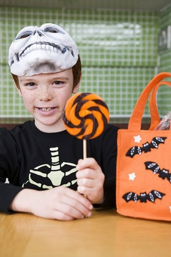 Stock Photo: 4029R-240418 Little boy with trick or treat sweets