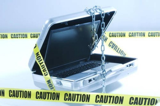 Stock Photo: 4029R-240616 Case with laptop covered in chains and cordon tape