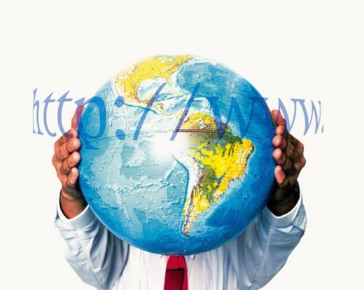 Businessman holding a globe with image of web address, CG, composition, front view : Stock Photo