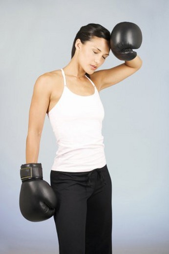 Stock Photo: 4029R-242218 A young woman boxing