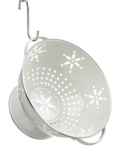 Empty colander hanging from hook : Stock Photo