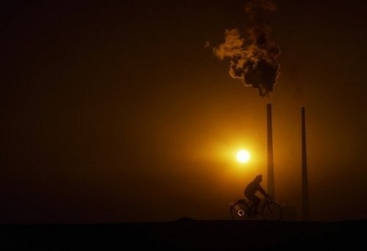 Stock Photo: 4029R-243867 Cycling by Power Station, Poolbeg, Dublin, Ireland