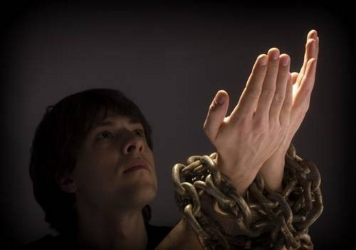 Man in chains : Stock Photo
