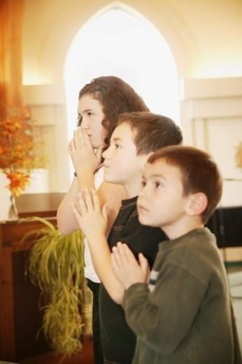 Children praying : Stock Photo