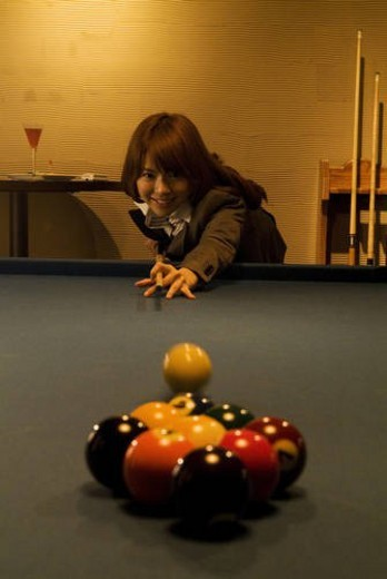 Stock Photo: 4029R-246214 Businesswoman playing pool