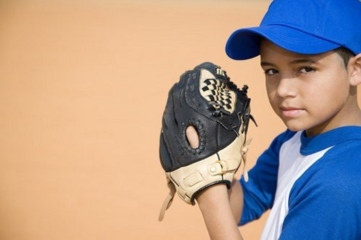 Stock Photo: 4029R-246865 Boy preparing to pitch baseball