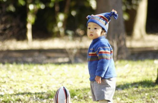 Stock Photo: 4029R-247037 Baby boy with knit hat and football, Tokyo Prefecture, Honshu, Japan