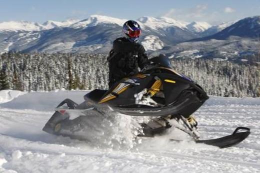 Stock Photo: 4029R-2485 snowmobile adventure tour in Whistler British Columbia