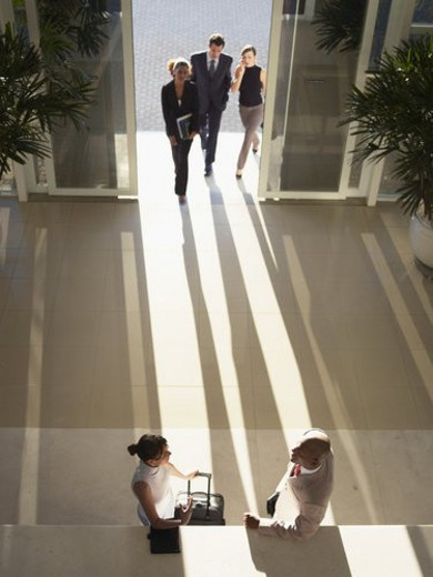 Businesspeople meeting in entrance hall (high angle view) : Stock Photo