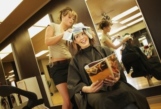 Stock Photo: 4029R-248797 A young woman having her hair highlighted