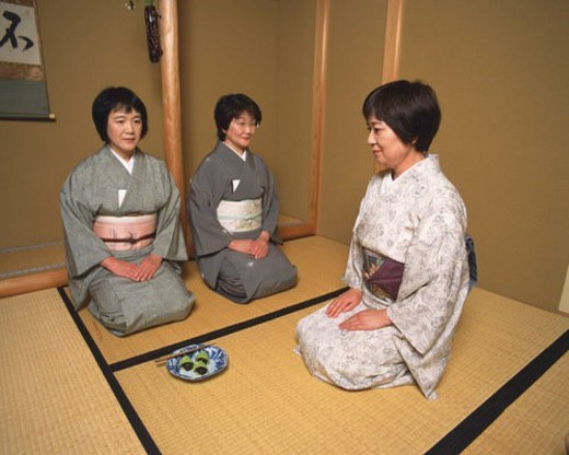 Stock Photo: 4029R-250127 Three women sitting on Tatami mat in a tea room, front view, side view, Japan