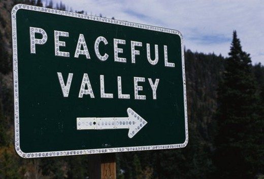 Stock Photo: 4029R-250244 This is a road signs that says Peaceful Valley