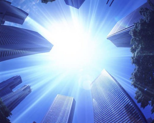 Stock Photo: 4029R-252115 Sun shining over skyscrapers