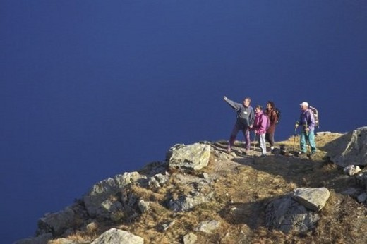 Group, Lake, mountain, mountainside, People, Rock, Water : Stock Photo