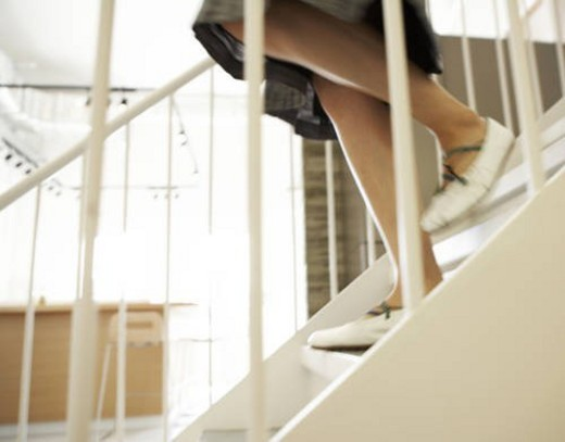 Stock Photo: 4029R-253007 Close-Up of Woman Walking Down Steps