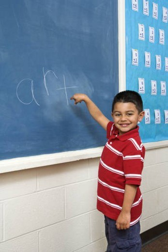Stock Photo: 4029R-255434 Boy in front of Blackboard
