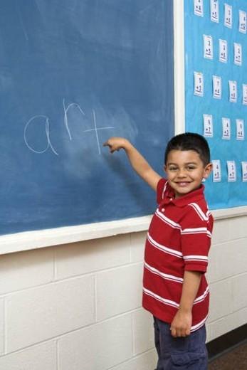 Boy in front of Blackboard : Stock Photo