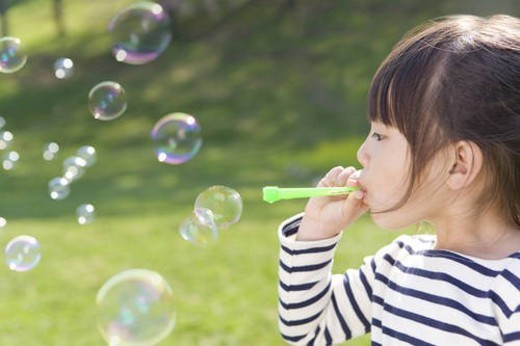 Stock Photo: 4029R-258062 A Girl Blowing Bubbles