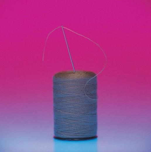 needle, spool of thread : Stock Photo