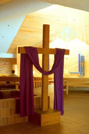 Cloth draped cross in the Nativity of Mary Catholic Church : Stock Photo