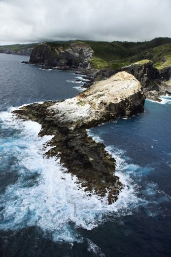 Stock Photo: 4029R-259433 Aerial view of rocky cliffs on coastline of Maui, Hawaii.