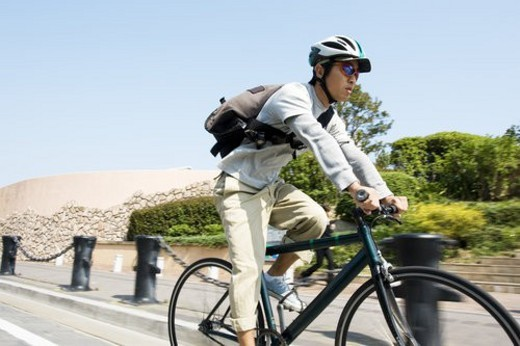 Stock Photo: 4029R-260445 The Messenger Who Runs By A Bicycle All Over A Town