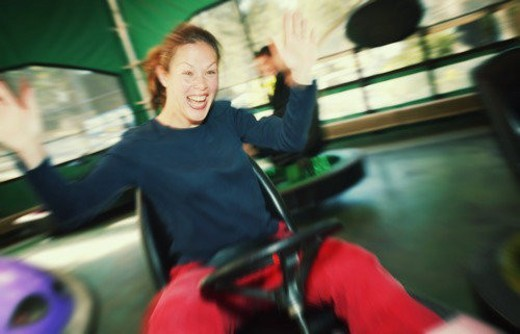 Woman at an amusement park : Stock Photo