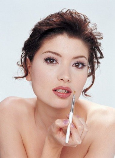 Stock Photo: 4029R-261146 Bodycare & Make Up, Hair Back, Looking At Camera, Lip Liner