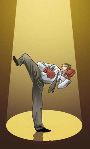 Businessman practicing kickboxing : Stock Photo