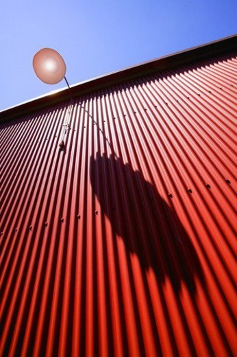 Stock Photo: 4029R-261428 Side view of red metal wall