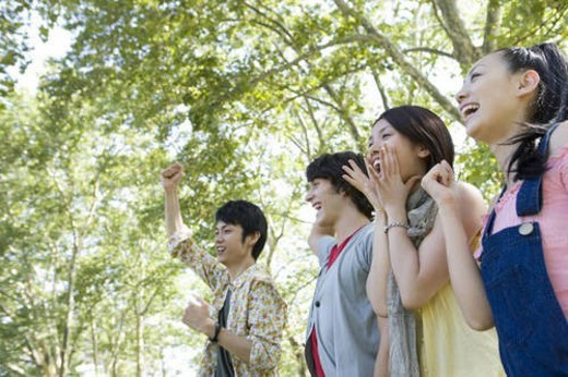 Stock Photo: 4029R-261833 Group of Young People Cheering Up Together