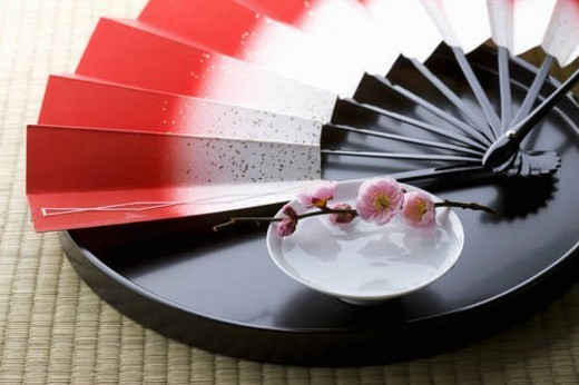 Sake and a folding fan on a tray : Stock Photo