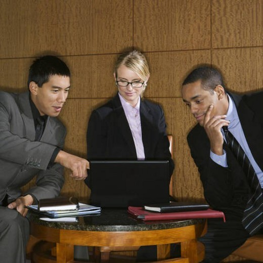 Stock Photo: 4029R-262475 Businesspeople Looking at Laptop